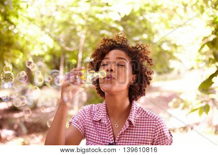 One Young Girl Blowing Sweet Bubbles