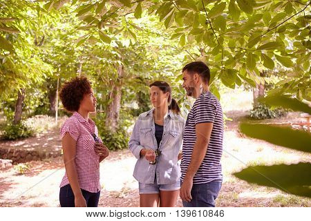 Three Young Friends Having A Discussion