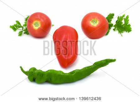 Green and red pepper lying on a white background in the form of face