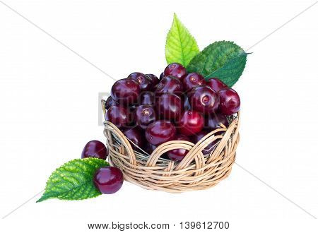 Ripe cherry in a wicker basket isolated on white background