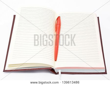 Open notepad and a red pen isolated on white background