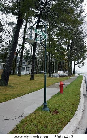 Street signs on a lamppost mark the intersection of Beach Drive and Artesian Way in Wequetonsing, Michigan.