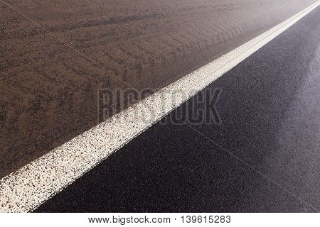 photographed close-up of the road for the movement of vehicles covered with snow, winter season, countryside, empty roadway,