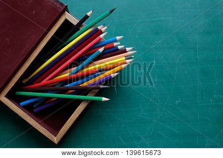 Colorful Pencils In Box On Desk