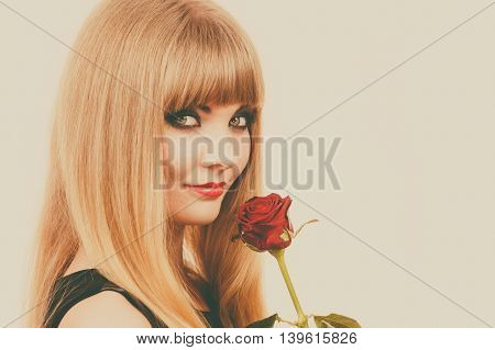 Beautiful Young Lady With Red Rose.