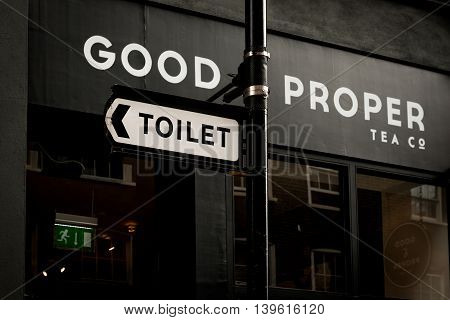 London United Kingdom - July 22 2016: Toilet sign at Leather Lane Street Market - street in Holborn with great streetfood fruit and vegetables and clothes stalls very popular with office workers Monday to Friday