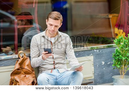 Man holding cellphone with empty copy space screen for your advertising text message or promotional content. Closely of businessman search information in network with smart phone