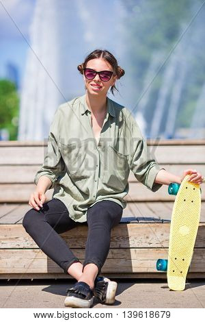 Girl having fun wit skate in the park