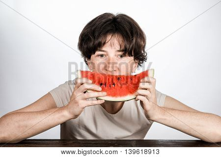 Female Eating A Melon