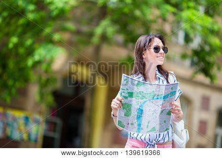 Travel tourist woman with map in Prague outdoors during holidays in Europe.