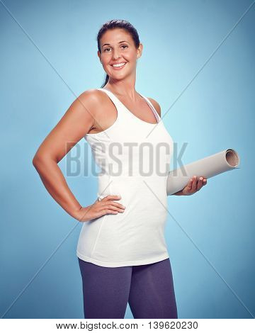 Happy Young Yoga Woman With Excercise Mat
