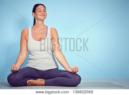 Young Yoga Woman Sitting In Lotus Position