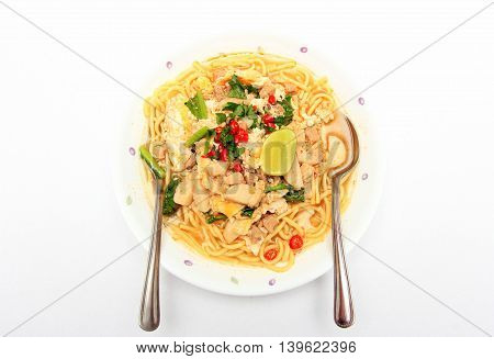 Bowl of spicy noodles on white background