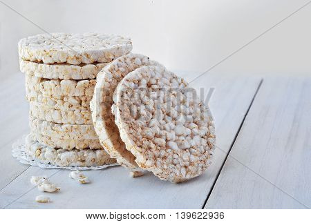 Round rice cakes on the white wood backgraund.