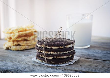 Chocolate coated rice cakes on the wood backgraund