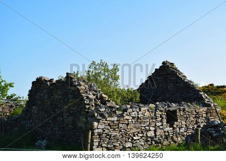 An old Irish stone famine house in Ireland