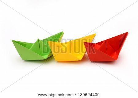 Colored paper boats, origami green red yellow