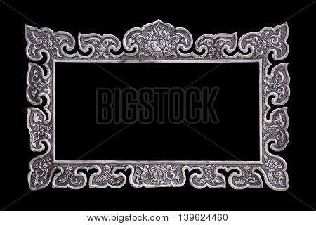 The Traditional Thai Style Handmade Silver Metal Carving Isolated On Black. Saved With Clipping Path
