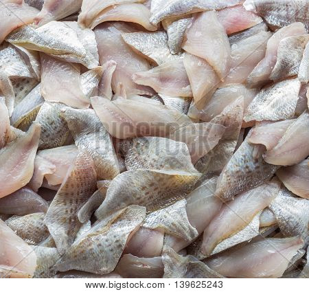 Top View Stack Of Sliced Raw, Fresh Fish After Filleting