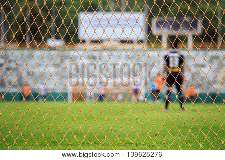 Soccer Net And Blur Of Player In Stadium