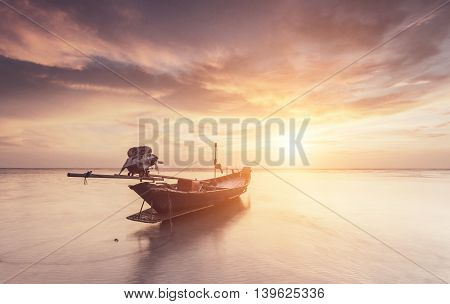 Traditional thai boats at the sea with beautiful sunset Thailand
