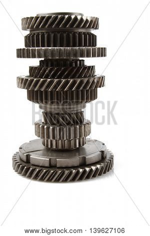 Steel cogs together on plain background