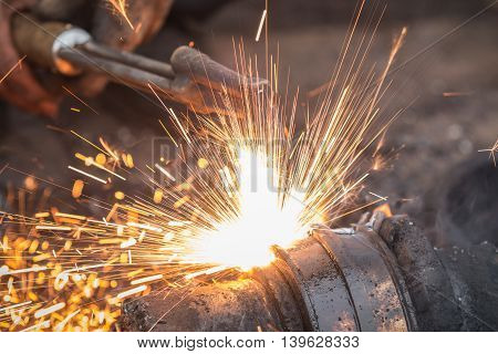 Worker Cutting Steel Using Metal Torch