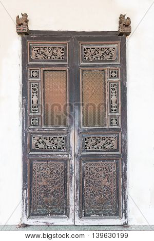 Ancient Chinese style woods door sasia background.