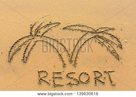 Inscription resort and palm trees drawn on sea beach sand.