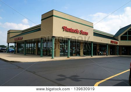 SHOREWOOD, ILLINOIS / UNITED STATES - AUGUST 30, 2015: One may have one's hair cut at Fantastic Sams, in a Shorewood strip mall.