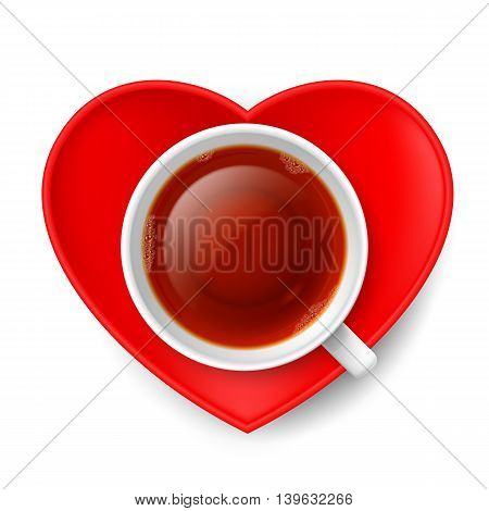 Cup of tea with red saucer in shape of heart