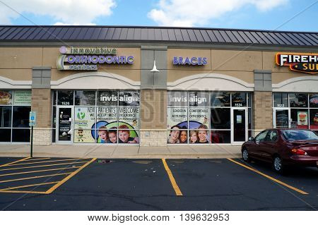 JOLIET, ILLINOIS / UNITED STATES - AUGUST 30, 2015: One may have one's teeth straightened at the Innovative Orthodontic Center in a Joliet strip mall.