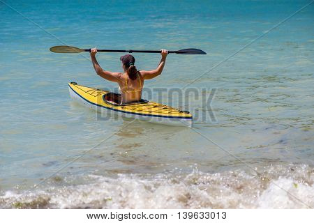 Young Woman Kayaking In The Sea