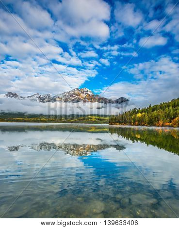 The Pyramids Lake in Canadian Rockies. Cold autumn morning. Concept  of vacation and tourism