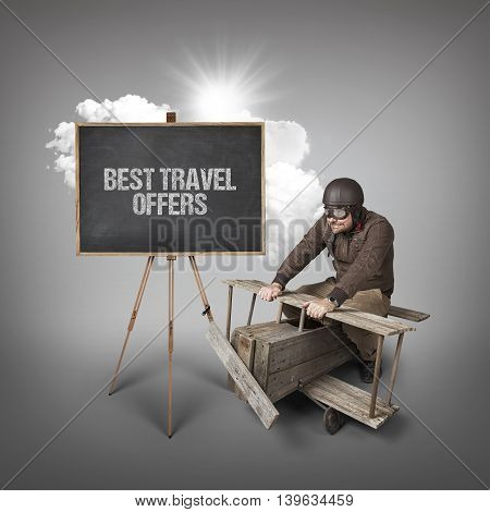 Best travel offers text on blackboard with businessman and wooden aeroplane