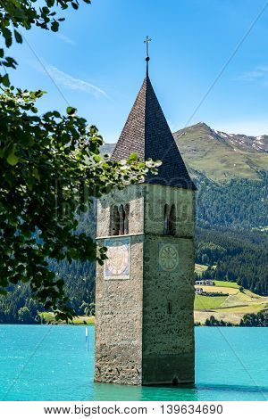 The submerged clock tower of lake Reschen Austria