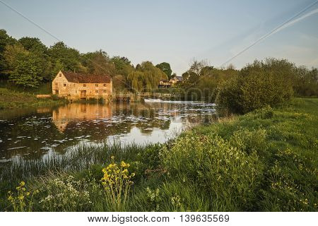 Early Morning Landscape Across River To Old Water Mill