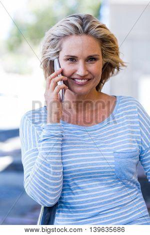 Portrait of happy pretty woman talking on cellphone