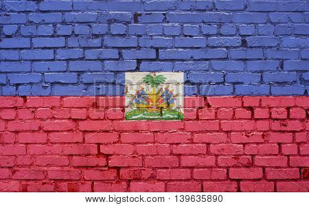 Flag of Haiti painted on brick wall background texture
