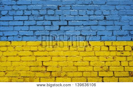 Flag of Ukraine painted on brick wall background texture