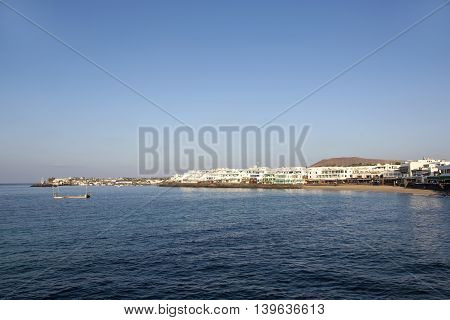promenade of scenic Playa Blanca with seaside in the morning