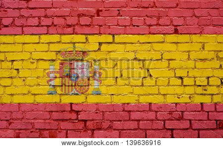 Flag of Spain painted on brick wall background texture