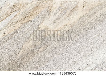 High mound of white crushed stone as a background