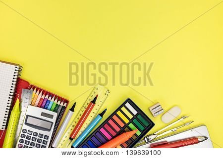 Pupil Workplace With Multicolored Pencils And Paints And Other Stationary