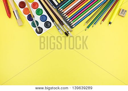 School And Office Supplies Ready For Pupils On Yellow Background