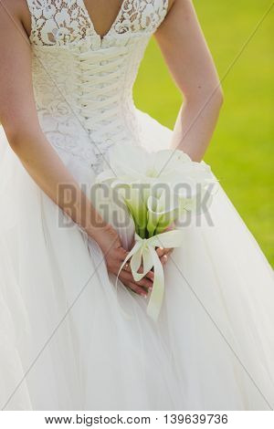wedding bouquet of flowers calla  in bride's hands