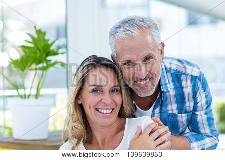 Close-up portrait of happy mature couple in restaurant