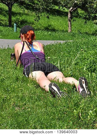 woman relaxing in the park on the grass in a day