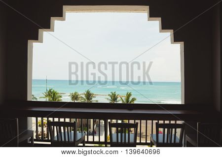 Three chairs in cafe with sea view