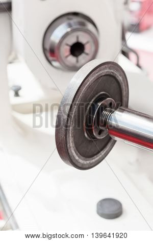 Diamond grinding wheel. Grinding CNC machine. Industrial background